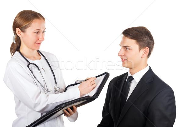 Arts jonge zakenman periodiek controleren vrouw Stockfoto © Obencem