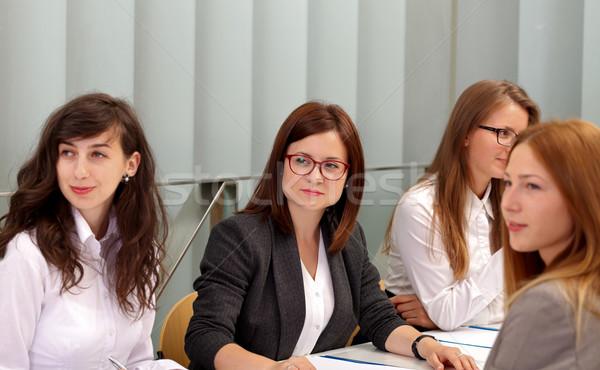 Reunião equipe de negócios sessão papel feliz equipe Foto stock © ocskaymark
