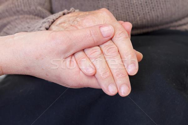 Giving help Stock photo © ocskaymark