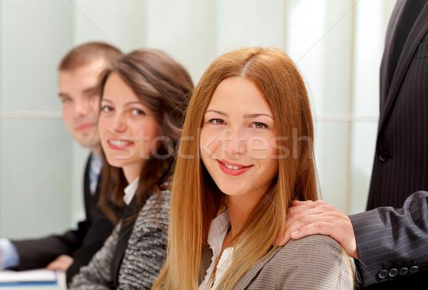 заседание красивой деловой женщины сидят бумаги счастливым Сток-фото © ocskaymark