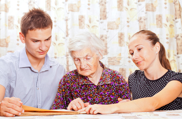 Elderly woman with the two young smileing grandchild Stock photo © ocskaymark