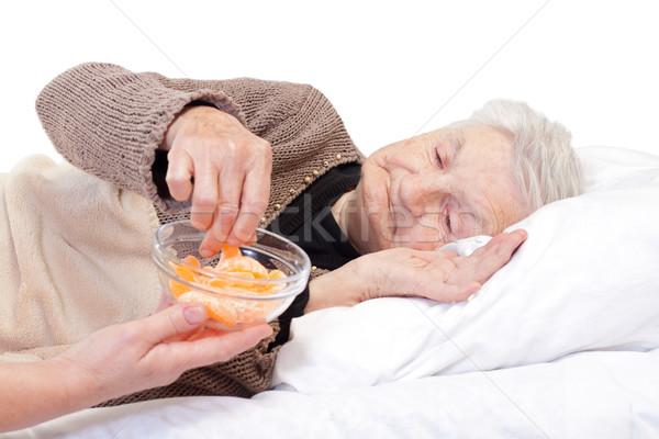 Egészséges élet idős nő eszik narancs betegség otthon Stock fotó © ocskaymark