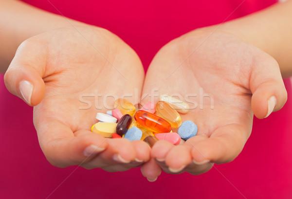 Malattia prevenzione mano pillole Foto d'archivio © ocskaymark