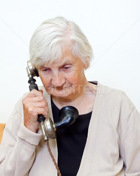 Hívás idős nő beszél retro telefon telefon Stock fotó © ocskaymark