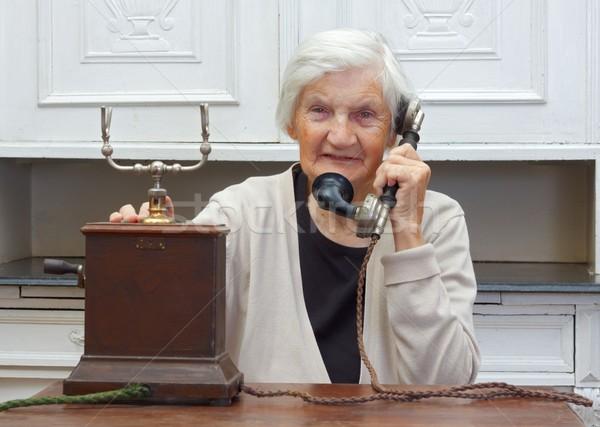 Hívás boldog idős nő beszél retro telefon Stock fotó © ocskaymark