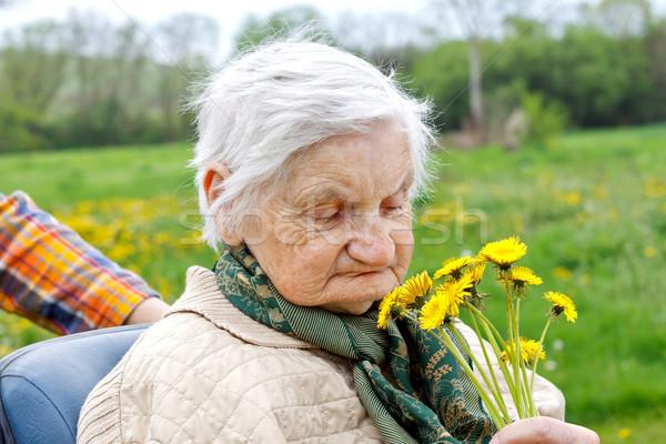 счастливым пожилого фотография желтый цветок Сток-фото © ocskaymark