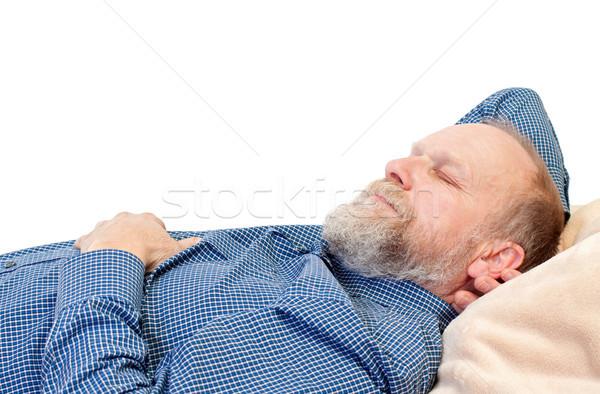 время пожилого мужчин спальный кровать изолированный Сток-фото © ocskaymark