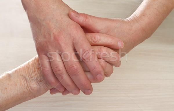 , держась за руки молодые стороны пожилого женщину Сток-фото © ocskaymark