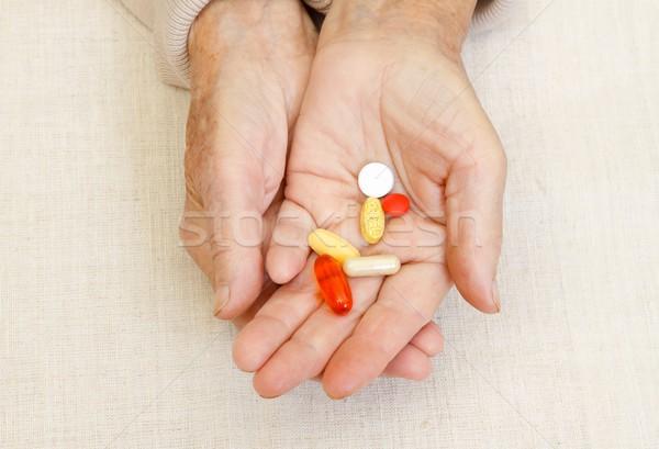 Holding pills Stock photo © ocskaymark