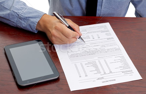 Signing a paper Stock photo © ocskaymark