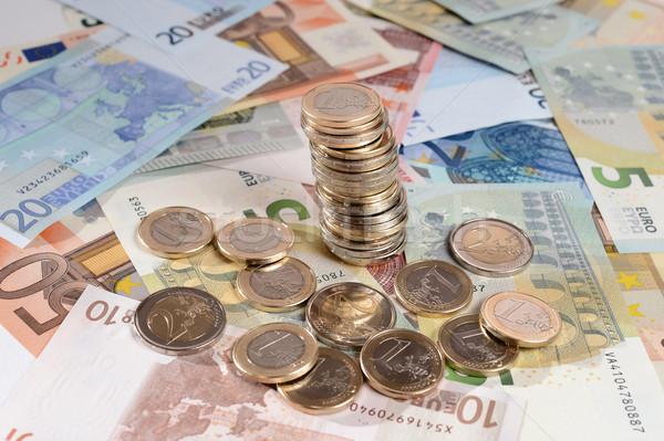 Euro bankjegyek boglya érmék izolált fehér Stock fotó © ocusfocus