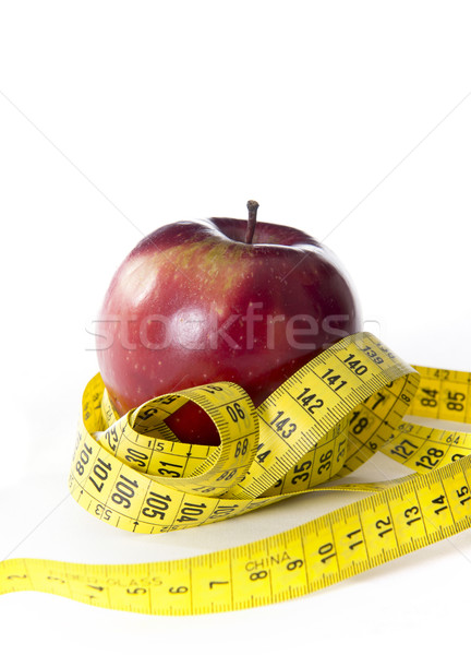 Apple wrapped in tailor tape Stock photo © ocusfocus
