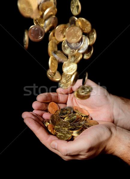 Adam eller tok para yağmur madeni para Stok fotoğraf © ocusfocus