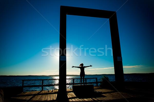 Genç kadın siluet açmak silah deniz yaz Stok fotoğraf © ocusfocus
