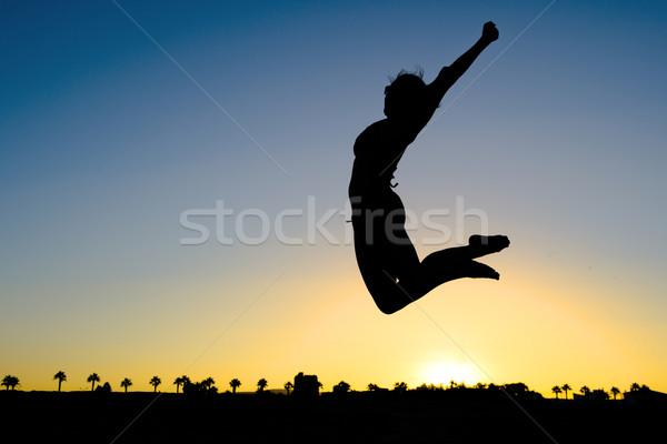 Kadın siluet atlama plaj gün batımı sağlık Stok fotoğraf © ocusfocus