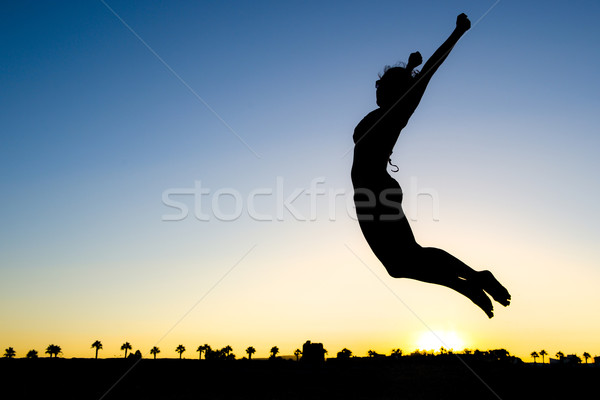 Woman Silhouette Jumping Stock photo © ocusfocus