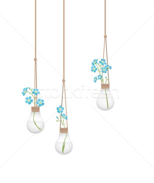 Stock photo: Flower in a light bulb