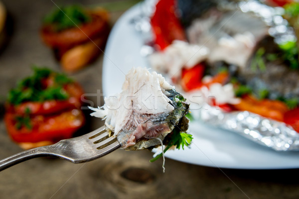 baked fish with bell peppers, onions and herbs Stock photo © oei1