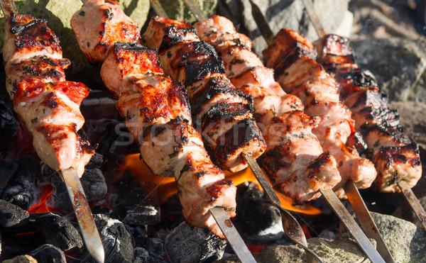 skewers of fresh pork roasted on coals Stock photo © oei1