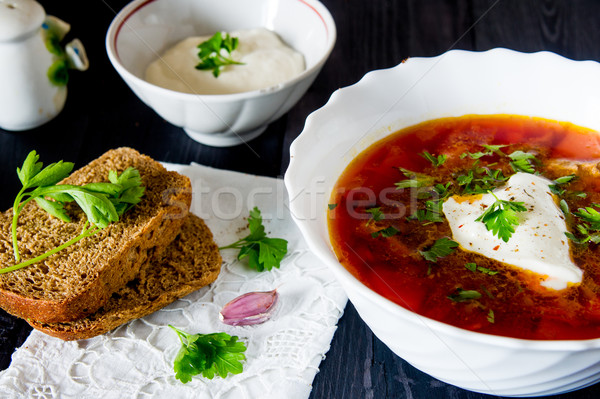 big bowl of borscht with sour cream and herbs Stock photo © oei1