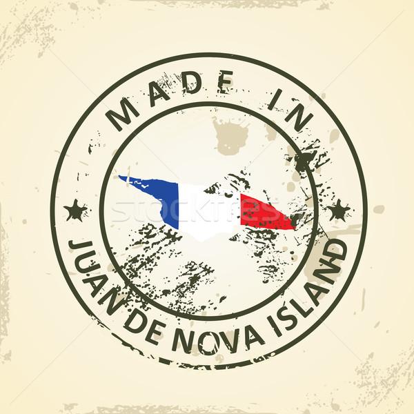 Stamp with map flag of Juan de Nova Island Stock photo © ojal