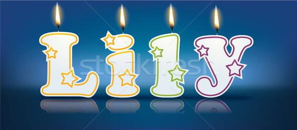 Lily écrit brûlant bougies lumière anniversaire Photo stock © ojal