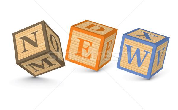 Stock photo: Word NEW written with alphabet blocks