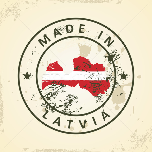 Stamp with map flag of Latvia Stock photo © ojal