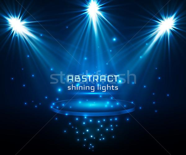 stage spot lighting. magic light. blue vector background Stock photo © olehsvetiukha