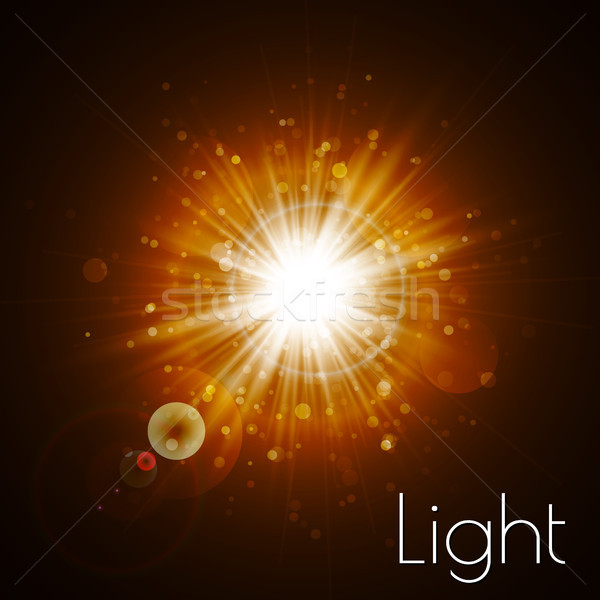 Star burst with sparkles. Light effect. Gold glitter texture Stock photo © olehsvetiukha