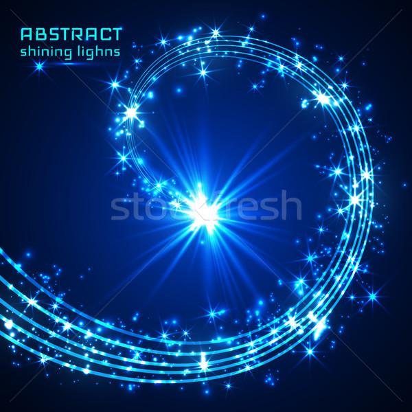 Blue magic sparkle glittering light Stock photo © olehsvetiukha