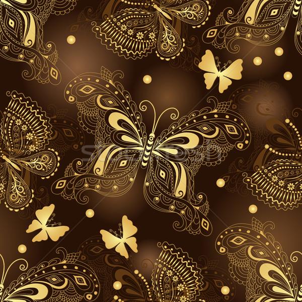Karanlık kahverengi model altın kelebekler Stok fotoğraf © OlgaDrozd