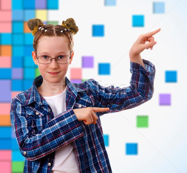 Smart Kid девушки указывая что-то пальца Сток-фото © OlgaYakovenko