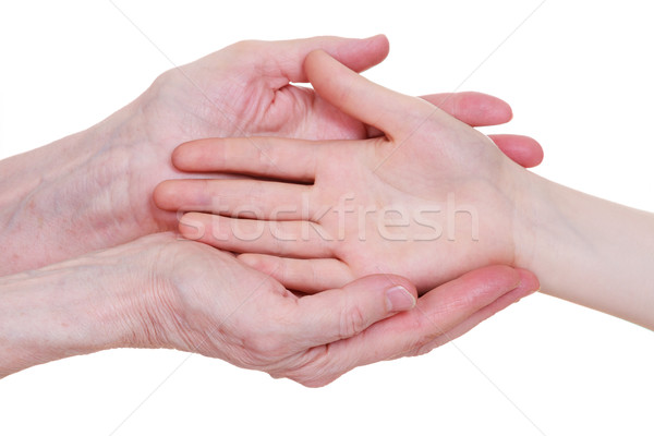 Old and young holding hands, isolated on a white background. Stock photo © OlgaYakovenko