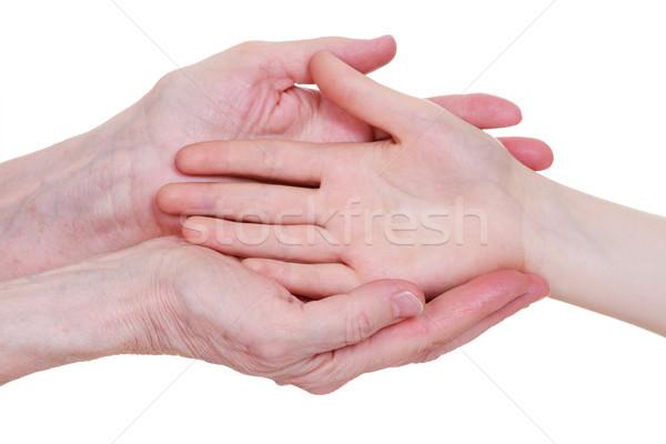 старые молодые , держась за руки изолированный белый стороны Сток-фото © OlgaYakovenko