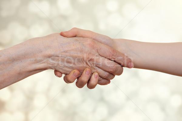Kézfogás idős személy ráncos kéz gyerek izolált Stock fotó © OlgaYakovenko
