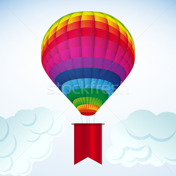 Background white clouds and colorful hot air balloon. Stock photo © OlgaYakovenko