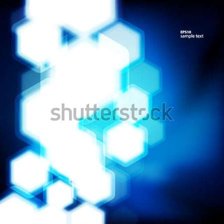Abstract blue background with hexagons bokeh defocused lights. Stock photo © OlgaYakovenko
