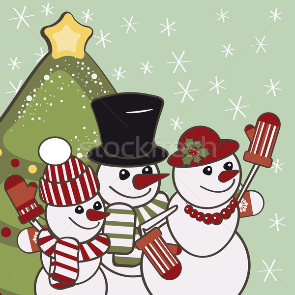 Retro Christmas card with a family of snowmen. Stock photo © OlgaYakovenko