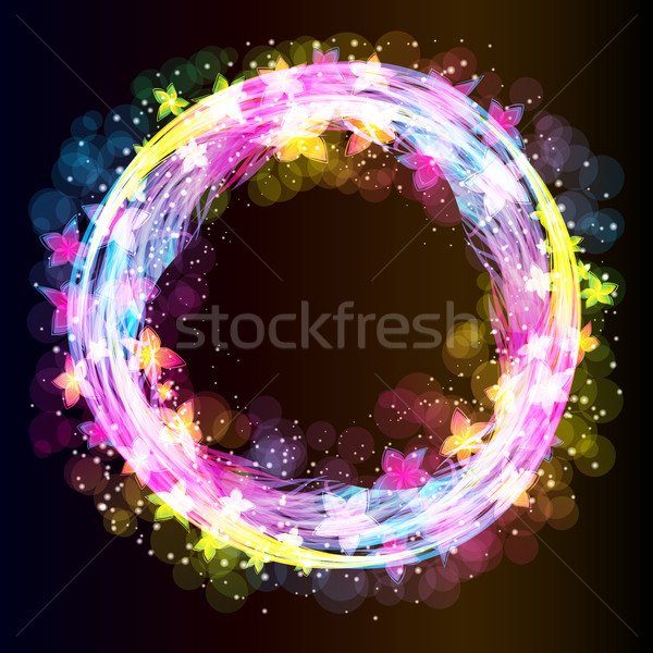 Ring of flowers and light on a dark background.  Stock photo © OlgaYakovenko