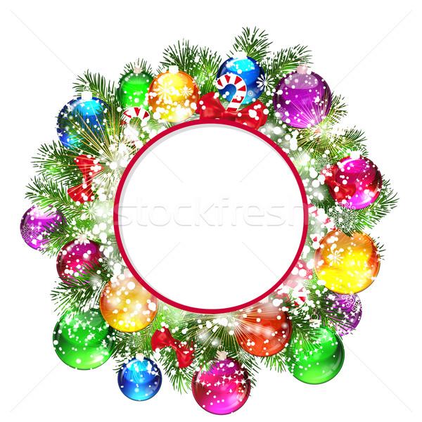 Christmas wreath with snow-covered branches of Christmas tree. Stock photo © OlgaYakovenko