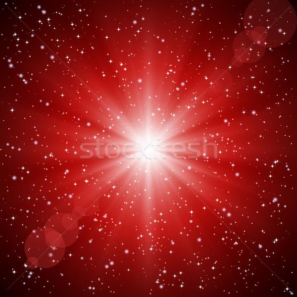Abstract red background of luminous rays and stars. Stock photo © OlgaYakovenko