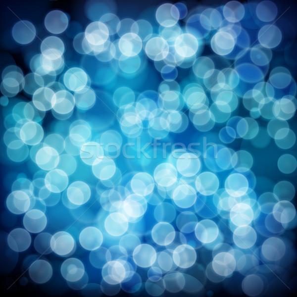 Blue abstract background with bokeh defocused lights. Stock photo © OlgaYakovenko