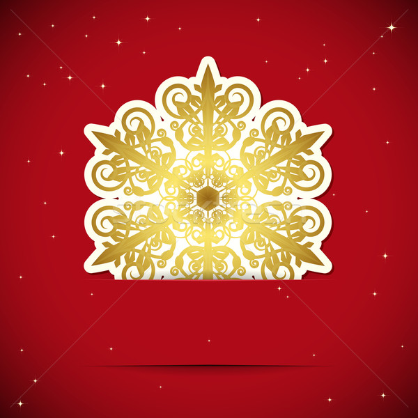 Christmas background. Snowflake inserted into a slot on the pape Stock photo © OlgaYakovenko