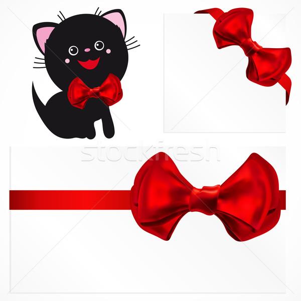 Pussycat and red gift bows.  Stock photo © OlgaYakovenko