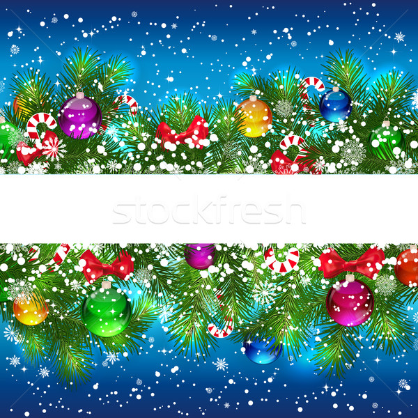 Christmas background with decorated branches of Christmas tree. Stock photo © OlgaYakovenko