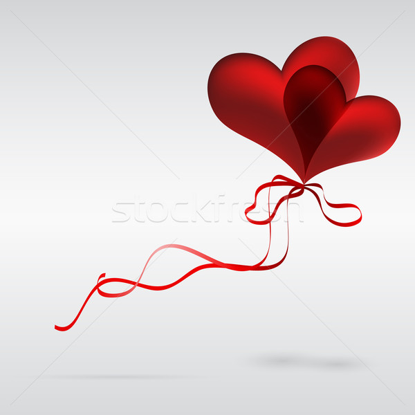 Flying a couple of balloons in the shape of a heart Stock photo © OlgaYakovenko