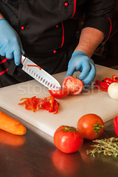 Chef cutting vegetables Stock photo © olira