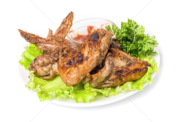 Tasty grilled chicken wings Stock photo © olira