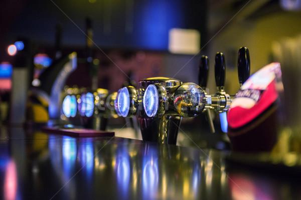 メタリック ビール 浅い 手 背景 ストックフォト © olira